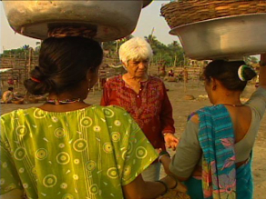Activist Nergis Irani speaks with local Dahanu fisherwomen in the shadow of the power  plant.