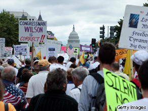 Protesters march to Capitol Hill during the Tea Party Express rally on September 12, 2009 in Washington, DC.