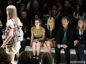 Celebrities enjoying a Burberry fashion show.