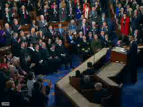The Supreme Court Justices remain seated while Democrats stand to applaud the President's criticism of the campaign finance ruling at the State of the Union address.