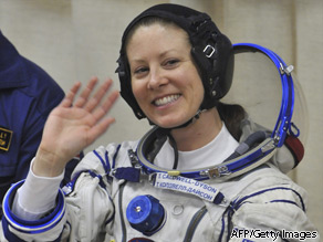 Astronaut Tracy Caldwell Dyson waves while getting into her space on April 2, 2010 for launch to the International Space Station.
