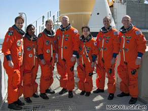 The astronauts of space shuttle Discovery's STS-131 mission assemble at the shuttle launch pad following their countdown dress rehearsal.