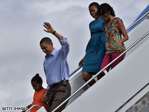 The first family is shown here in a 2009 photo leaving Air Force One upon arrival in Hawaii for vacation.