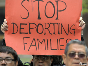 Immigration activists express opposition.