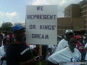 A man holds a sign at the 'Restoring the Dream' rally in Washington on Saturday.