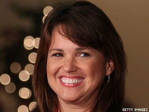 U.S. Senate candidate Christine O'Donnell smiles at supporters before doing a television interview at her Senate primary night party on September 14, 2010 in Dover, Delaware.