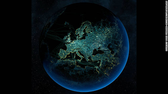 Major road and rail networks in Europe, along with transmission lines and underwater cables are superimposed above the continent's cities illuminated at night.