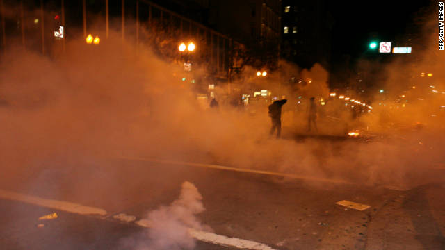 Occupy Oakland protesters run away as the police shoot tear gas canisters near the Oakland City Hall late last month.