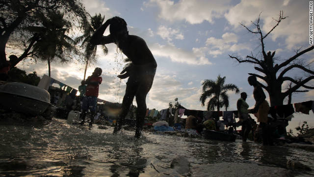 People bathe in a river in Port-au-Prince in January 2012. Cholera, though not indigenous to Haiti, remains rampant there.