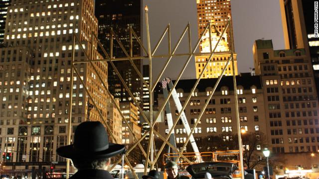 New Yorkers light a massive menorah in Manhattan on Tuesday to mark the beginning of Hanukkah.