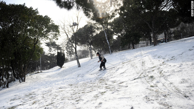 <br/>A skier takes advantage of the unusual snowfall in Istanbul, Turkey, on Tuesday, January 31. The snow paralyzed daily life there.