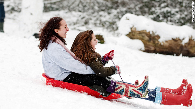 <br/>Two girls sled down the hill in Alexandra Park in London on Sunday, February 5. London is the latest European capital to be hit by winter weather making its way west, after Rome was blanketed in a rare snowfall Saturday.