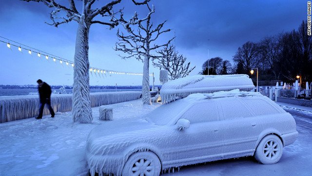 <br/>A man walks past an ice-covered car on the frozen waterside promenade at Lake Geneva in Versoix, Switzerland, early Sunday, February 5.