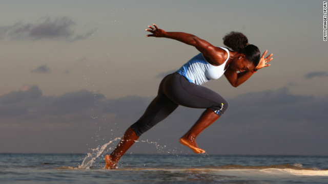 black women sprinting out of the water, running to the right