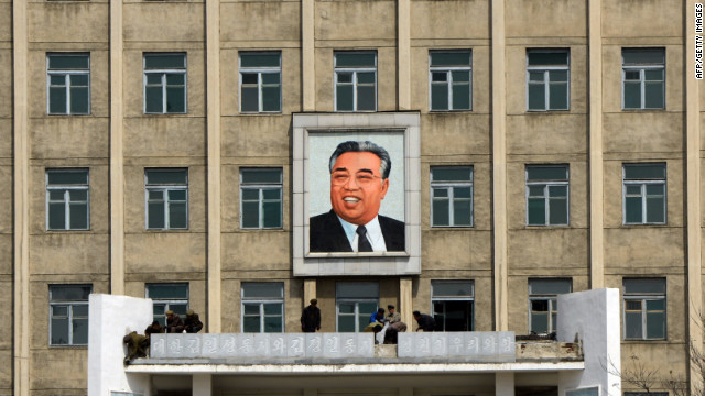 A building adorned with a huge portrait of the late president Kim Il-Sung is cleaned by workers in Pyongyang.