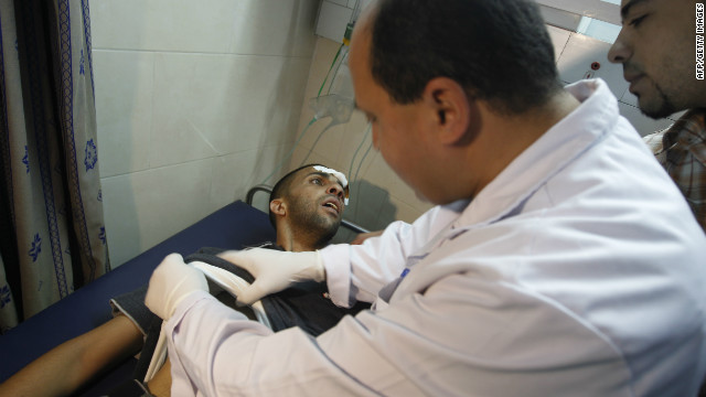 A Palestinian doctor attends to a wounded man at a hospital in Gaza City on Thursday.