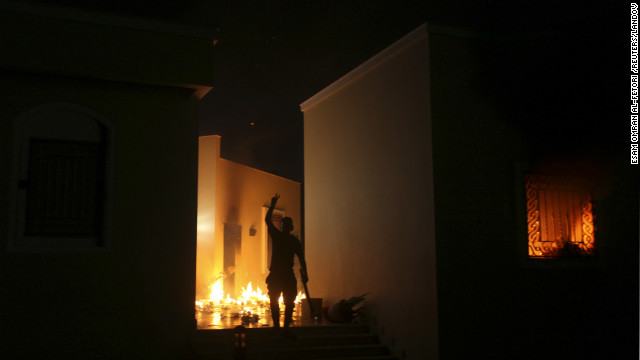 A protester reacts as the U.S. Consulate in Benghazi burns Tuesday night.