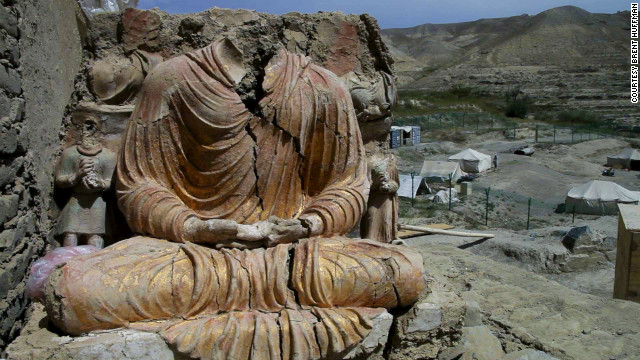 A Buddhist statue overlooks a Chinese government-owned mining compound in Logar province, Afghanistan. Mes Aynak, a 2,600-year-old Buddhist site, could be destroyed in December to create a massive copper mine.