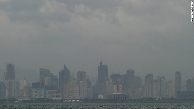 The skyline of downtown Manila is shrouded in cloud and haze, brought on by Tropical storm Son-Tinh on Thursday.