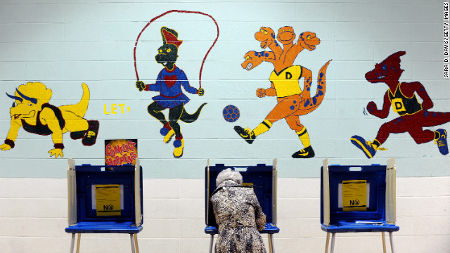 A voter casts her ballot in the gymnasium of Douglas Elementary School in Raleigh, North Carolina. As Americans go to vote Tuesday. President Barack Obama and Republican presidential candidate Mitt Romney are in a virtual tie in the national polls.