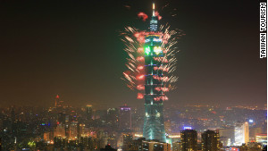 The Taipei 101 tower is lit up by fireworks.