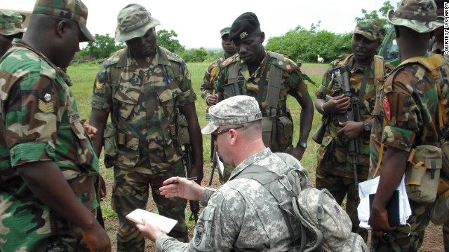 Sgt. Grady Hyatt of the U.S. Army's Africa Command discusses an action plan with members of the Ghana Army.