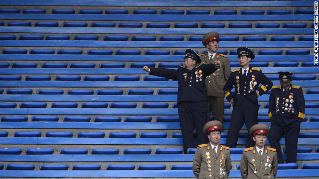 North Korean soldiers relax at the end of an official ceremony attended by leader Kim Jong Un at a stadium in Pyongyang on April 14, 2012.