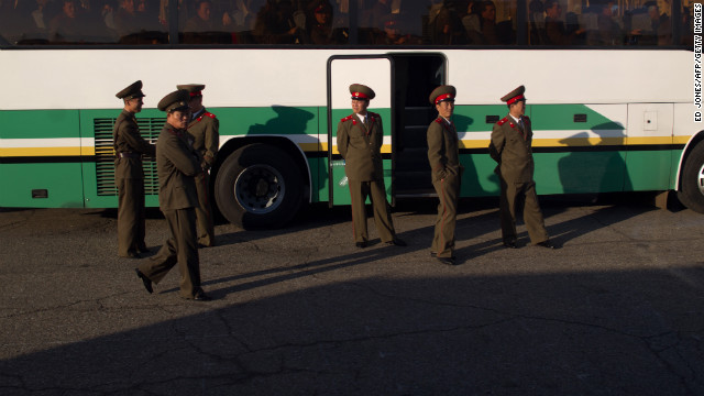 Soldiers board a bus outside a theater in Pyongyang on April 16, 2012.