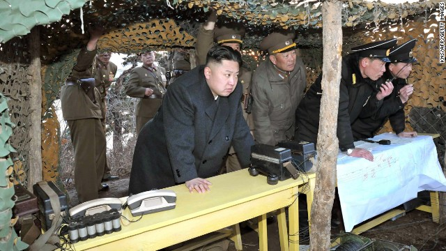 North Korean leader Kim Jong Un inspects drills by the Korean People's Army navy at an undisclosed location on North Korea's east coast on March 25 in a photo from the state-run Korean Central News Agency.