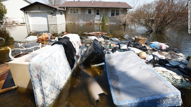 Household items are submerged in floodwaters in front of a house in Fox Lake, Illinois, on Monday, April 22. Steady rains are expected Tuesday, April 23, in several Midwestern states already facing severe flooding. Have you been affected by the flooding? <a href='http://ireport.cnn.com/topics/962945' target='_blank'>Share your images with CNN iReport</a>.