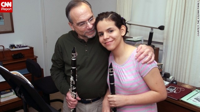 13-year-old Mano Kolman and her father, Barry, prepare to play a clarinet duet together.