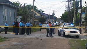 Law enforcement investigates the scene of a mass shooting at a Mother\'s Day parade in New Orleans on May 12, 2013.