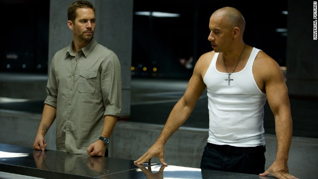 "Walker (l.) and Vin Diesel appear in a scene from ""Fast & Furious 6."" Walker's role as Brian O'Conner in the franchise helped to make the actor a star."