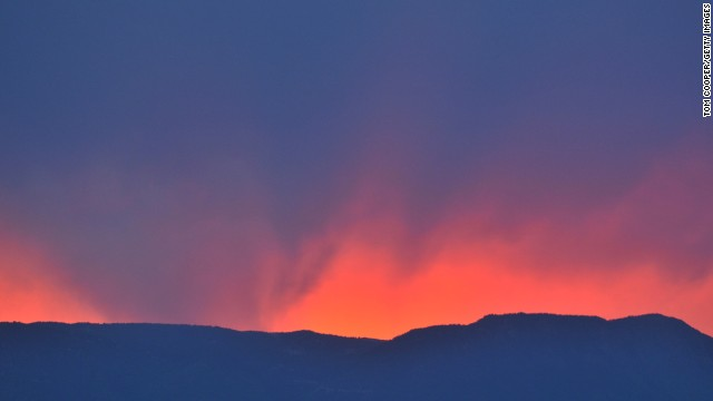 An orange sky highlights a fire on Thursday, June 13, that has been burning since June 11 near Colorado Springs. <a href='http://www.cnn.com/2013/06/14/us/colorado-fires/index.html?hpt=hp_t1'>Two major wildfires </a>are scorching thousands of acres and destroying hundreds of homes in the state.