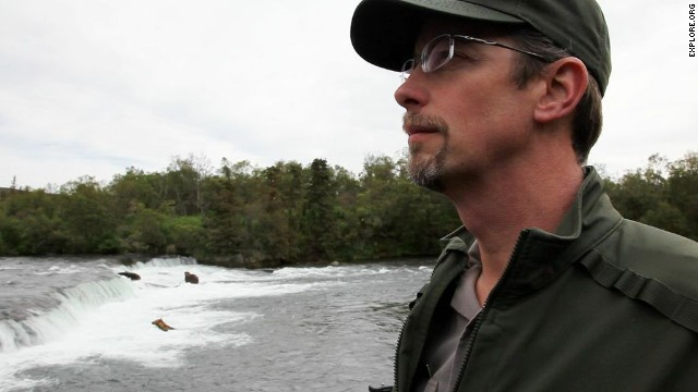 Park ranger Roy Wood, seen here at Brooks Falls, has worked at Katmai National Park and Preserve since 2003.
