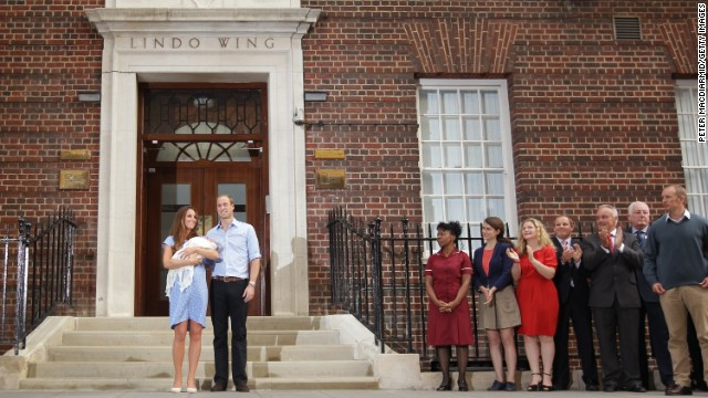 The new parents stand in front of the Lindo Wing of the hospital.