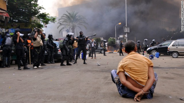 A Morsy supporter sits under arrest at Cairo's Nahda Square on August 14.