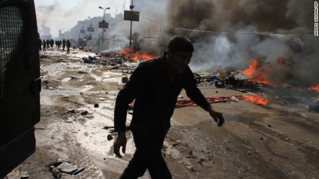 The scene from a street in Cairo's Nasr City appears chaotic as security forces clear a sit-in August 14.