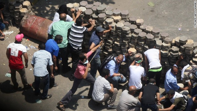 Morsy supporters confront police at Cairo's Mustafa Mahmoud Square on August 14.