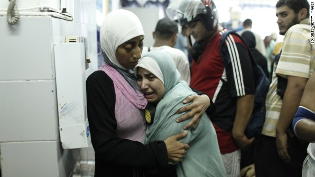 A Morsy supporter reacts after identifying the body of a dead family member at the Rabaa al-Adaweya Medical Centre on August 14 in Cairo.