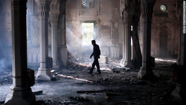 A man walks inside the burned-out Rabaa Al-Adawiya mosque in Cairo on August 15.