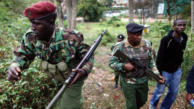 Kenyan paramilitary police officers patrol the area near the Westgate Mall in Nairobi, Kenya, where hostages are being held for the second day on Sunday, September 22. Gunmen burst into the mall and opened fire in a deadly attack on September 21. Kenyan government and Western diplomatic sources said Al-Shabaab militants were holding about 30 hostages inside the shopping center on Sunday. As grim-faced Kenyan soldiers warily searched the five-story building -- and as Al-Shabaab maintained its defiant stance -- the siege was no closer to a resolution.