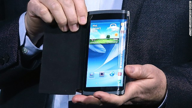 Samsung's Brian Berkeley shows a prototype smartphone with a curved screen at the Consumer Electronics Show in January.
