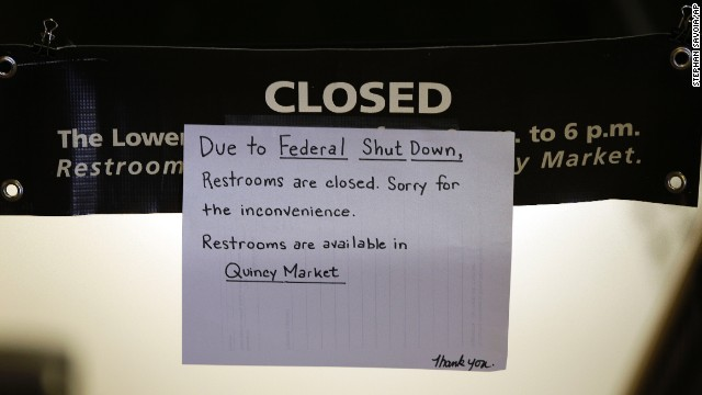 A hand-written sign informs visitors to Faneuil Hall, the nation's oldest public meeting hall, that restrooms are closed as a result of the partial government shutdown in Boston, on October 1.