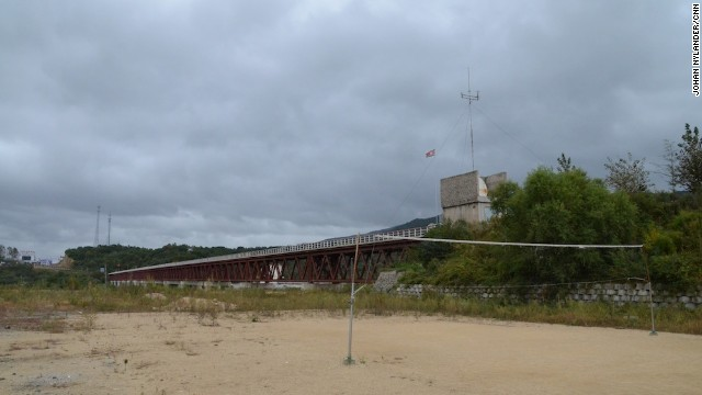 By the border checkpoint next to the Tumen River, North Korean customs officials can play volleyball. Officials prohibited any photos of North Korean military bases.