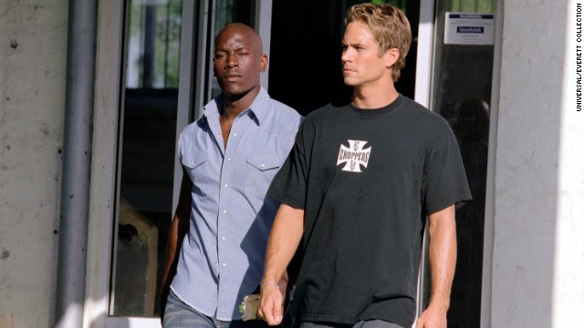 "Tyrese Gibson (l.) and Walker appear in ""2 Fast 2 Furious."""