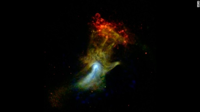 "Is that a giant hand waving at us? Actually, it's what's left of a star that died and exploded a long time ago. Astronomers nicknamed it the ""Hand of God."" <a href='http://www.jpl.nasa.gov/spaceimages/details.php?id=PIA17566' target='_blank'>NASA's Nuclear Spectroscopic Telescope Array, or NuSTAR</a>, took this image in high-energy X-rays, shown in blue. The image was combined with images from another space telescope, the Chandra X-ray Observatory."