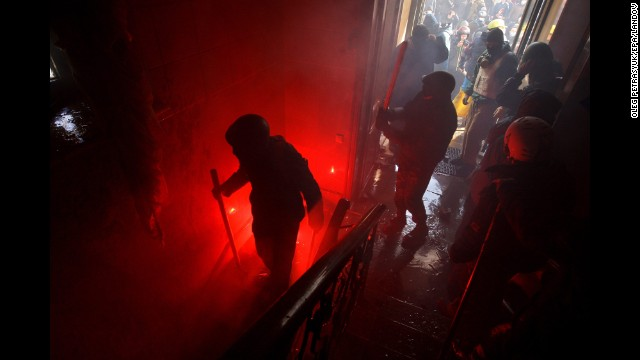 Protesters invade the main office of the ruling Party of Regions in Kiev on February 18.