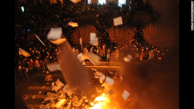 Protesters in Lviv burn papers from a government building on February 19.