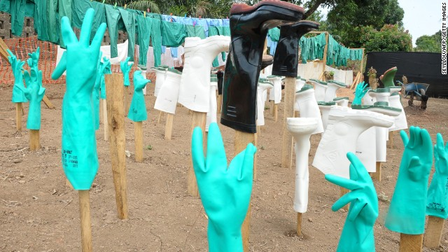 Gloves and boots used by medical personnel dry in the sun April 1 outside a center for Ebola victims in Gueckedou.